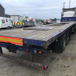 44ft flat bed tri axle flat bed with coil v Trailer on drum brakes